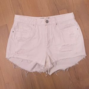 Distressed white jean shorts